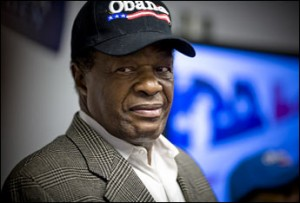 Marion Barry wearing an Obama for president cap.